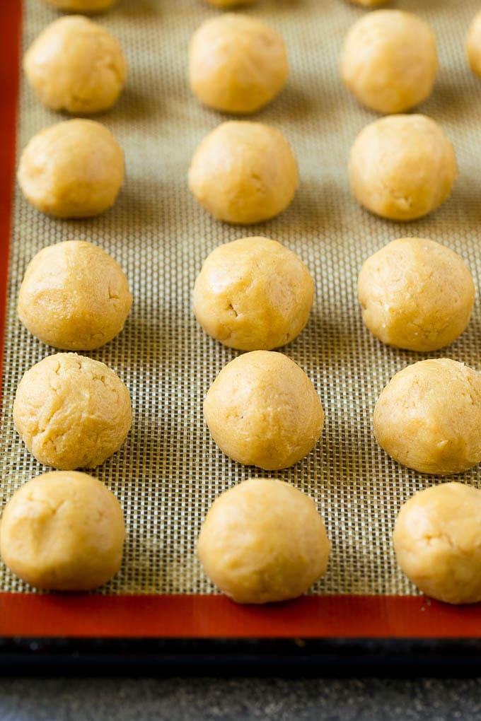 Balls of peanut butter cookie dough.