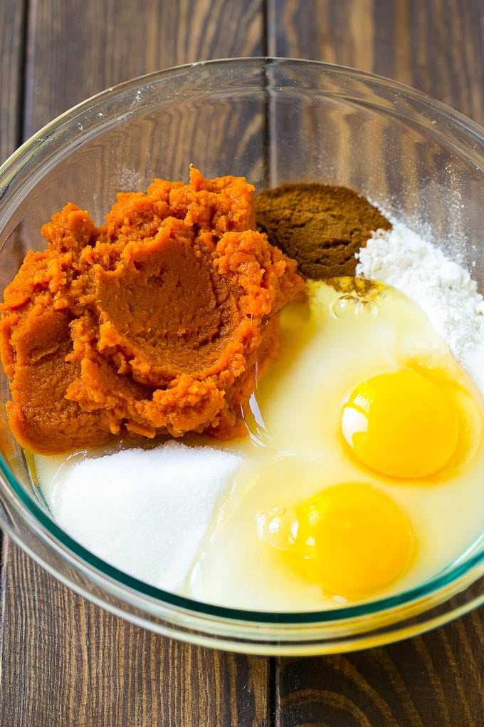 Sugar, eggs, pumpkin puree, flour and spices in a mixing bowl.