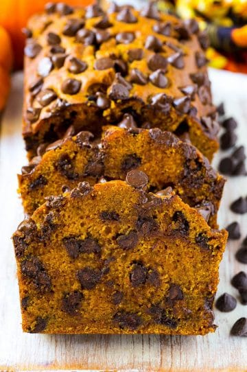 Sliced pumpkin chocolate chip bread on a serving board.