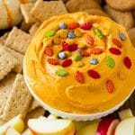 Pumpkin dip served with apples, gingersnap cookies and graham crackers.