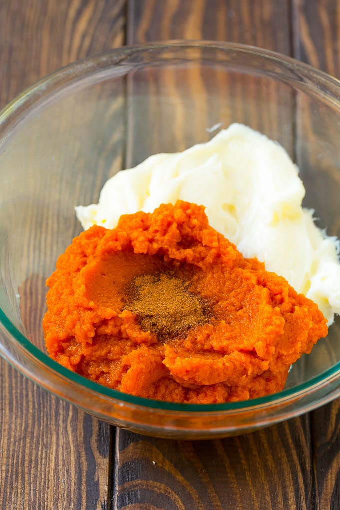 Pumpkin puree, cream cheese and spices in a bowl.