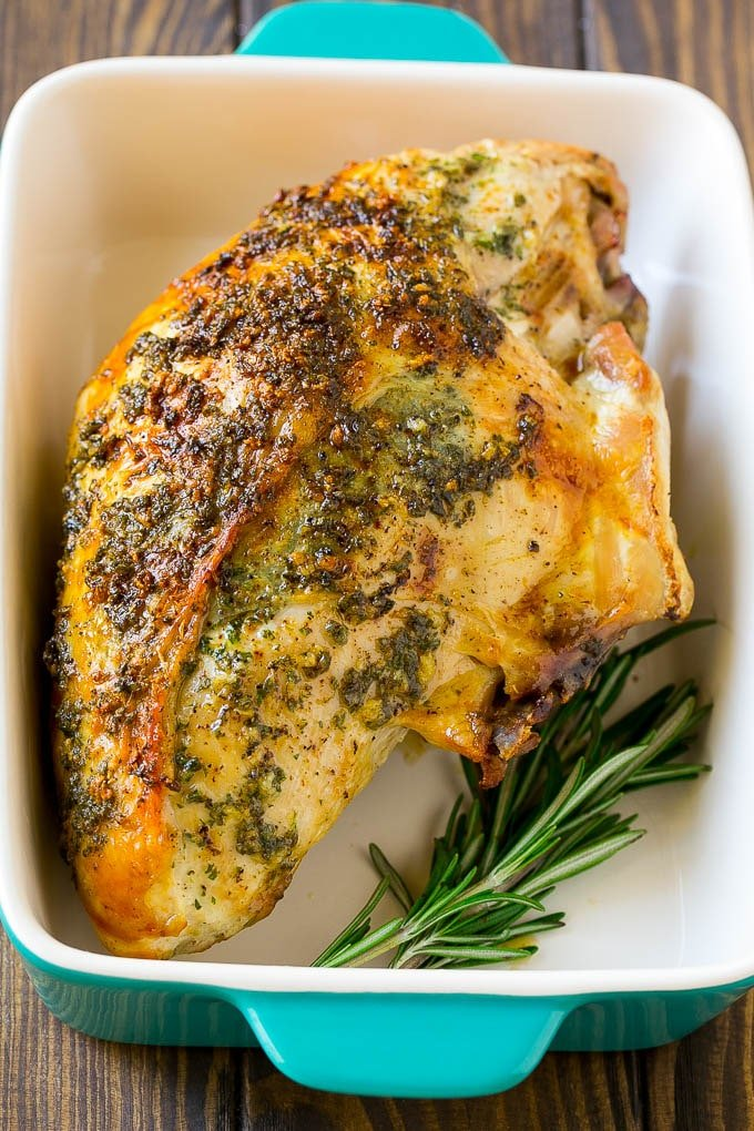 A roasted turkey breast in a baking dish.