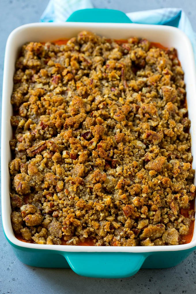 A baking dish of Ruth's Chris sweet potato casserole topped with streusel.