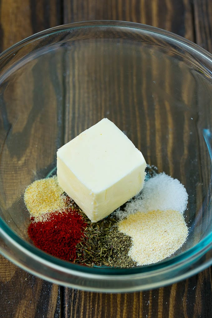 Butter and seasonings in a mixing bowl.