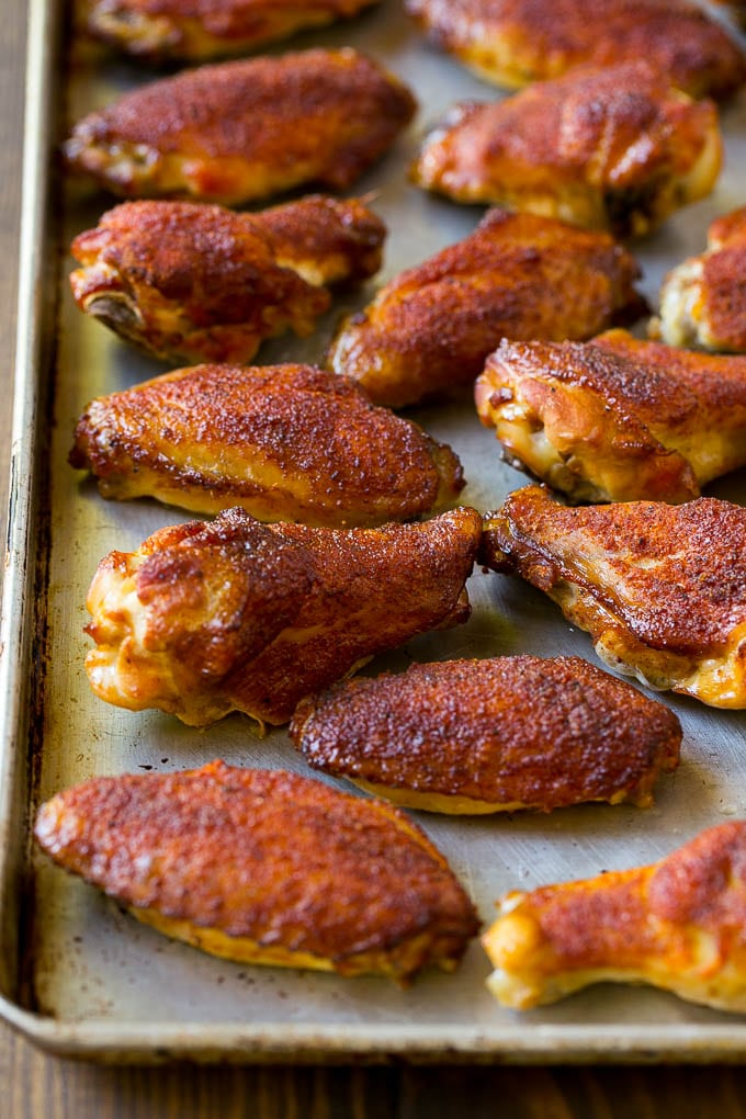 Smoked chicken wings coated in spice rub on a sheet pan.