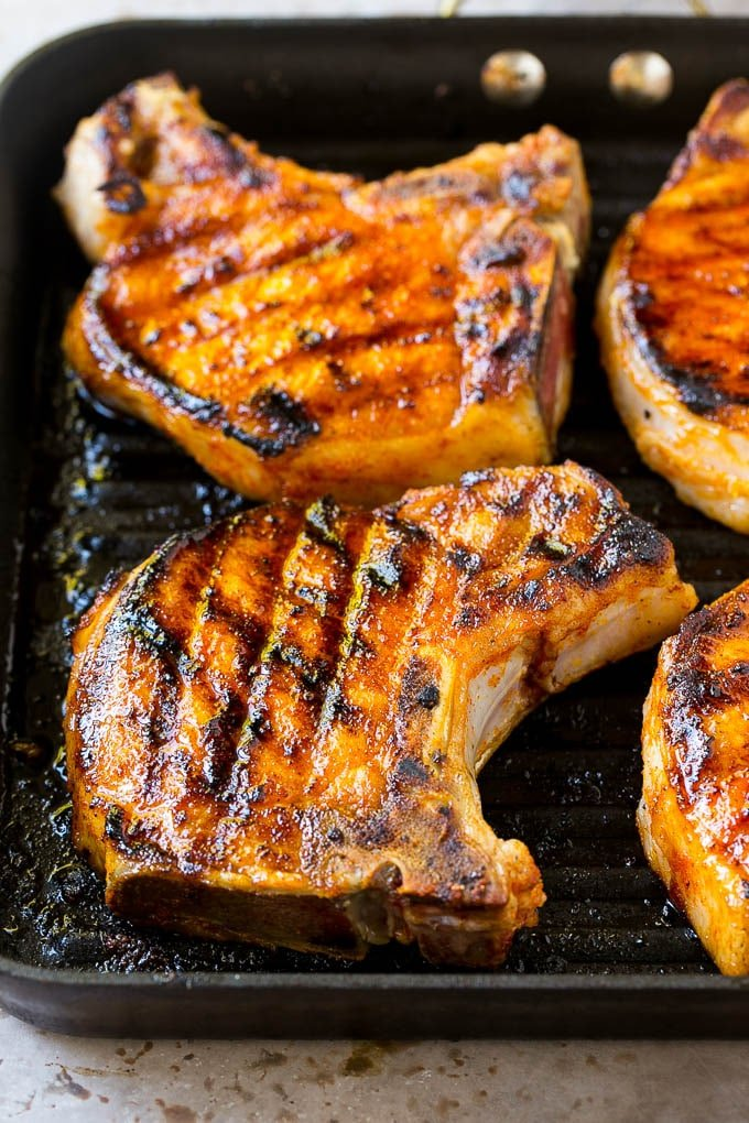 Seared pork chops in a grill pan.