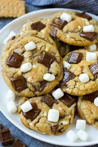 A plate of S'mores cookies topped with milk chocolate bars and marshmallows.