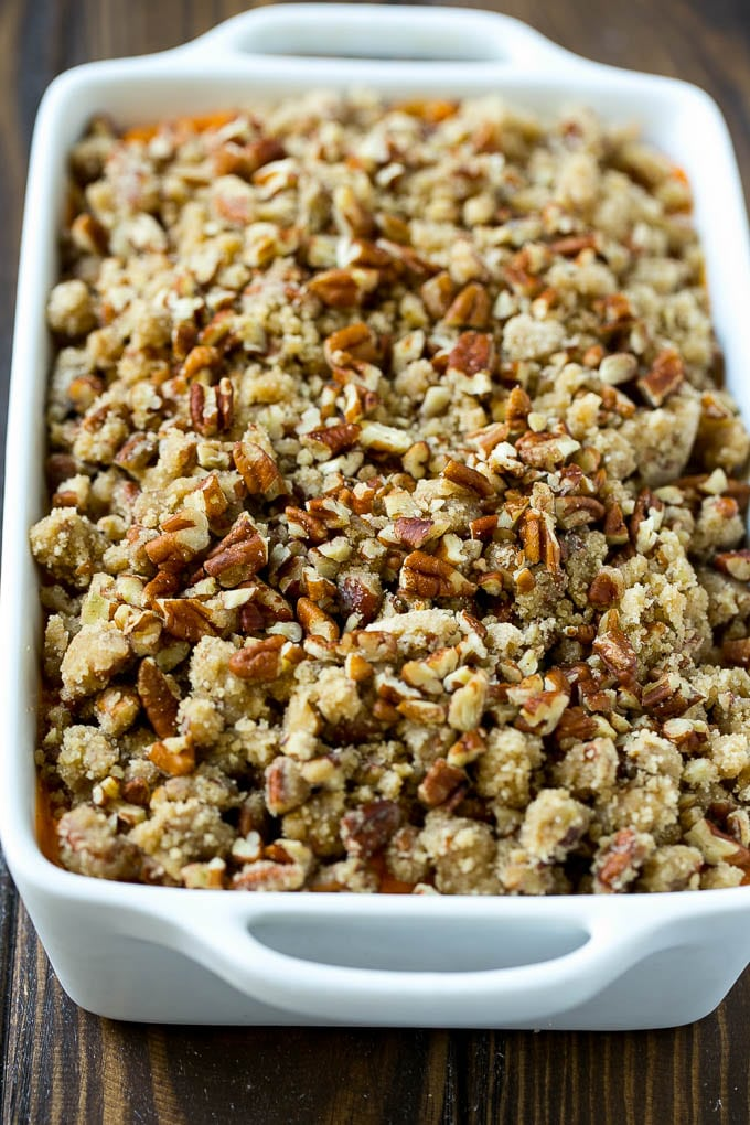 An uncooked sweet potato casserole with pecan streusel.