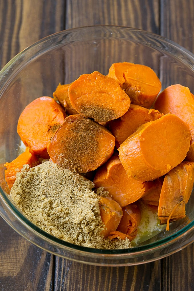 Sliced sweet potatoes with brown sugar, butter and spices.