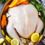 A whole turkey in turkey brine which is made with citrus, herbs and spices.