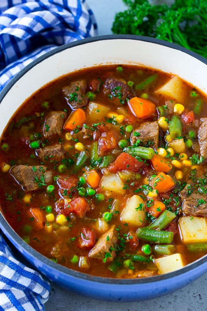 Vegetable beef soup made with chunks of beef, carrots, potatoes, green beans, corn and peas.