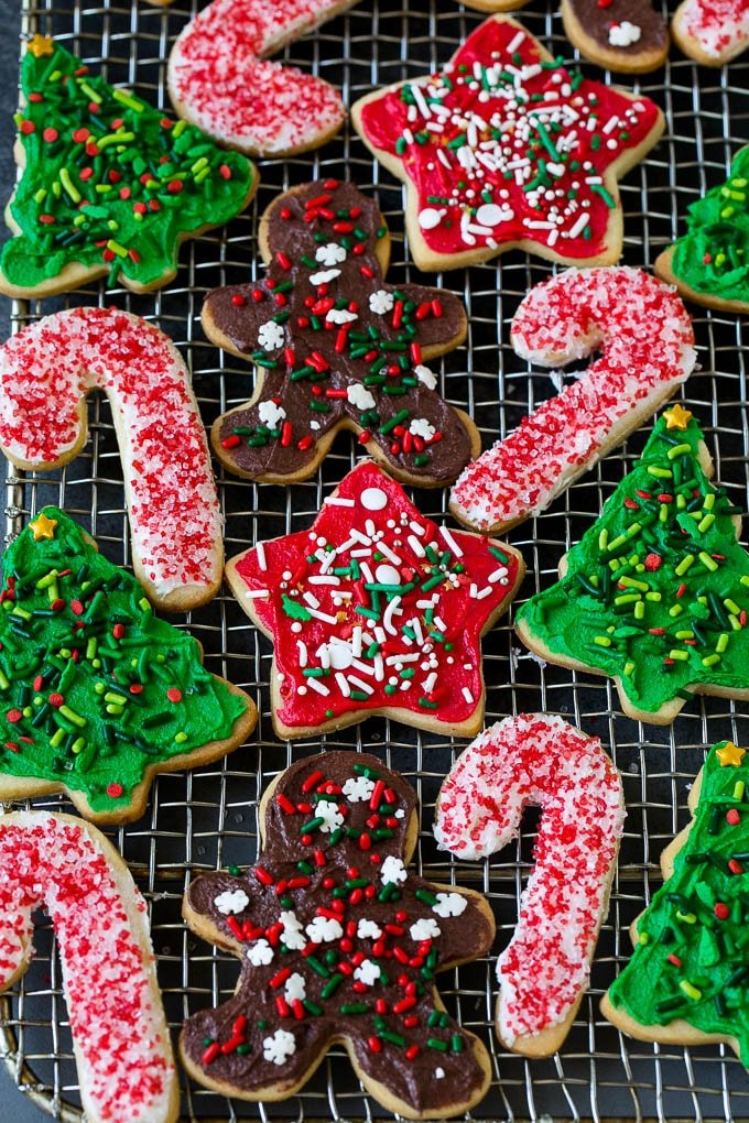 Decorated Christmas cookies on a cooling rack.