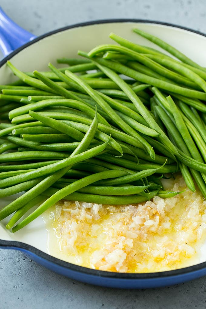 Green beans, shallots and butter in a skillet.