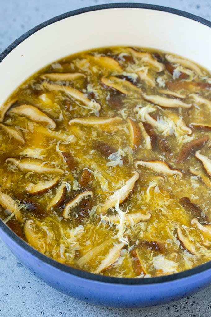 Mushrooms, egg strands and bamboo shoots in broth for hot and sour soup.