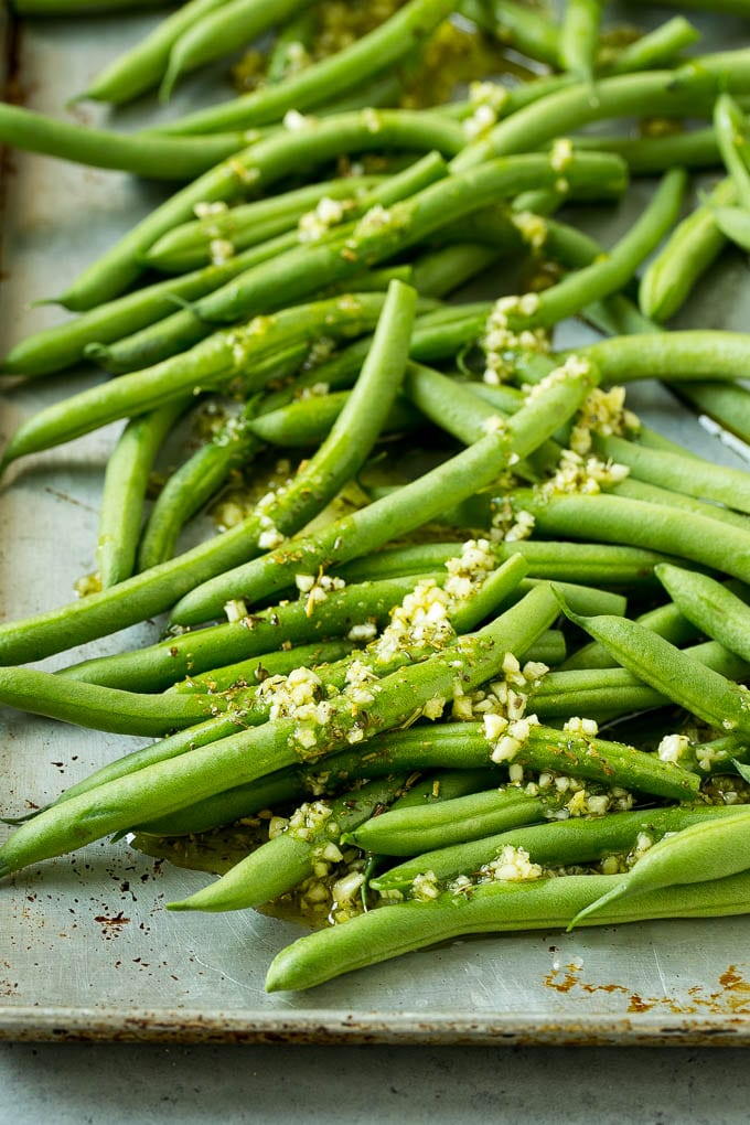 Raw green beans drizzled with butter, olive oil, garlic and herbs.