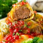 Stuffed cabbage rolls filled with beef and rice then topped with homemade tomato sauce.
