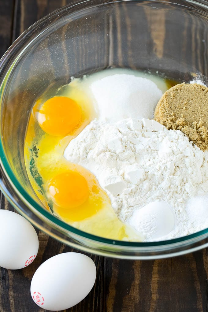 Flour, sugar, baking powder and eggs in a mixing bowl.