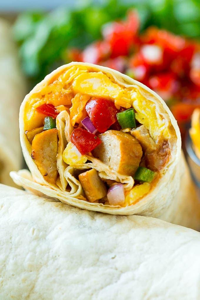 A breakfast burrito stuffed with sausage, eggs, pico de gallo and cheese.