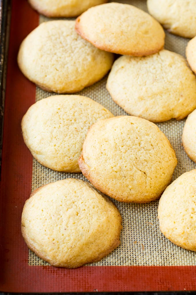 Baked eggnog cookies on a sheet pan.