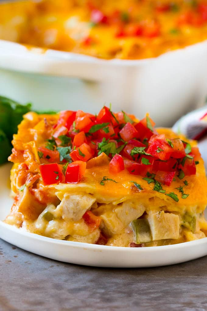 A serving of King Ranch chicken with creamy chicken, tomatoes, vegetables and cheese layered between corn tortillas.