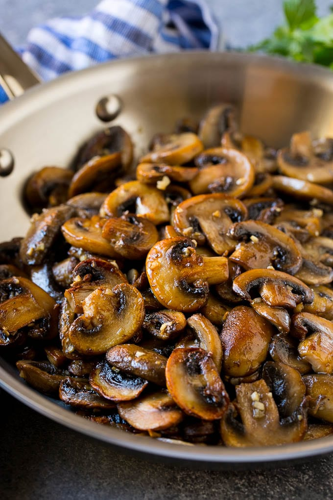 Sauteed mushrooms in garlic butter in a skillet.