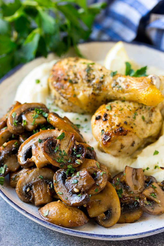 Sauteed mushrooms served alongside chicken and mashed potatoes.
