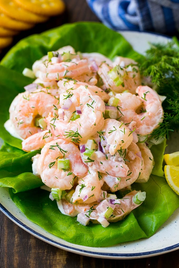 Creamy shrimp salad served over lettuce with crackers on the side.