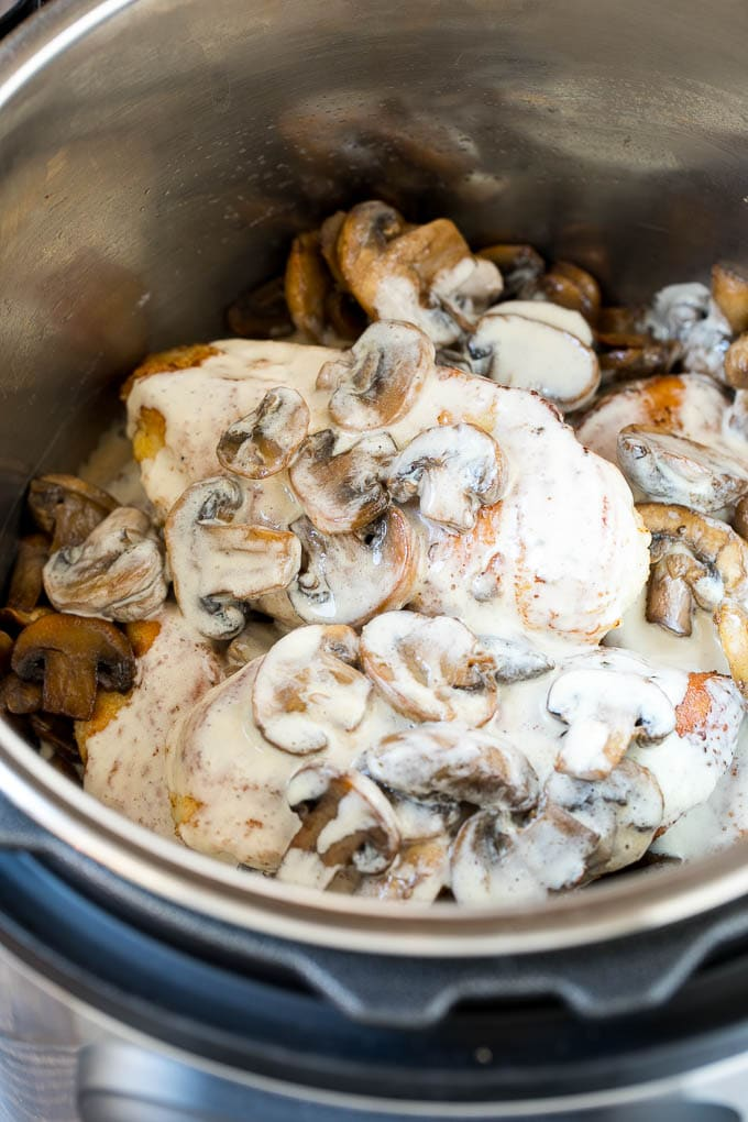 Chicken breasts with sauteed mushrooms and creamy sauce in an Instant Pot.