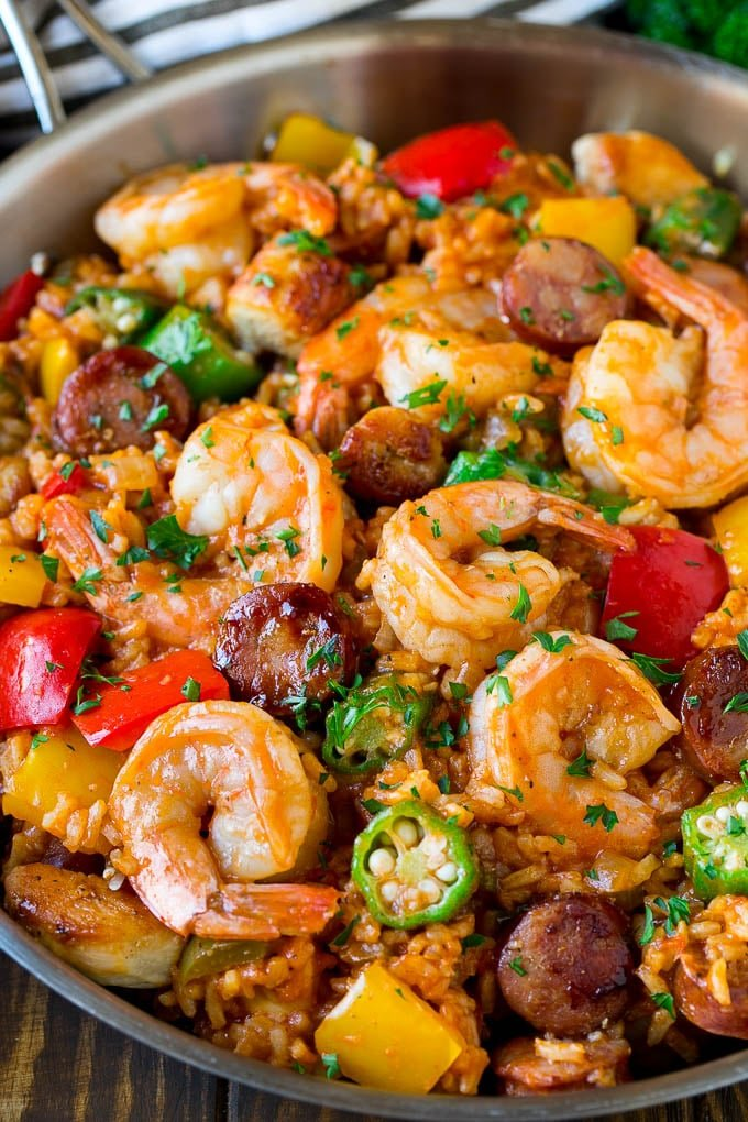 A pan of jambalaya made with shrimp, sausage, chicken, rice and vegetables.