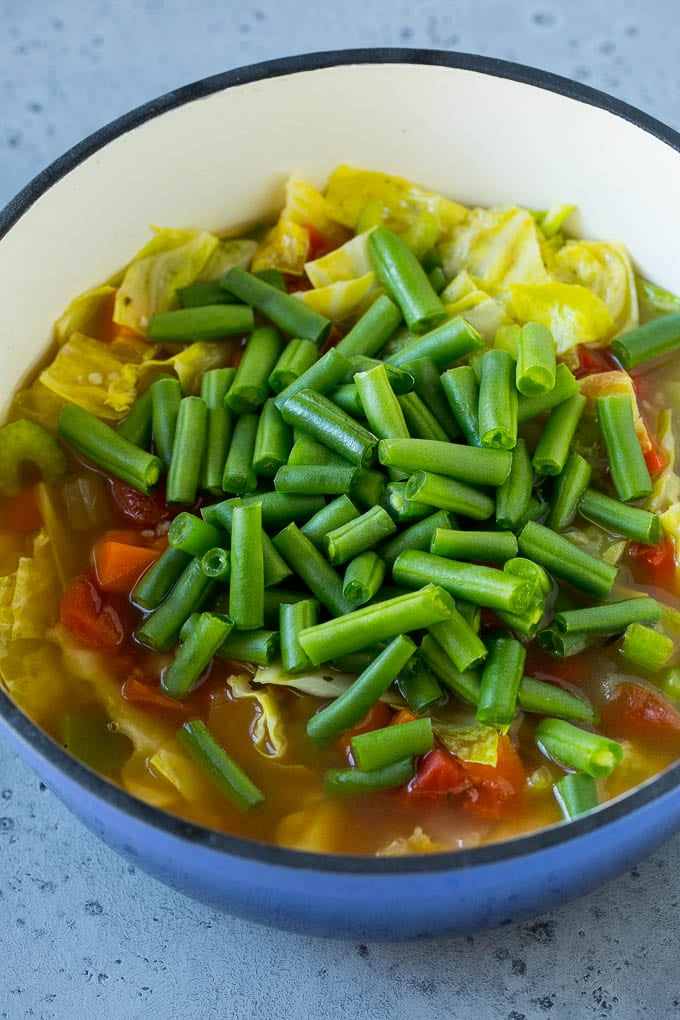 Green beans in a pot of cabbage soup.