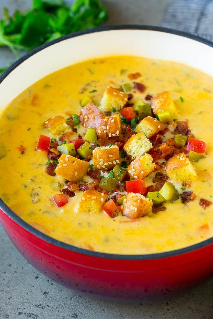 Cheeseburger soup topped with bacon, tomato, pickles and croutons.