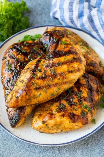 Chicken breasts made with the best chicken marinade then grilled and topped with parsley.