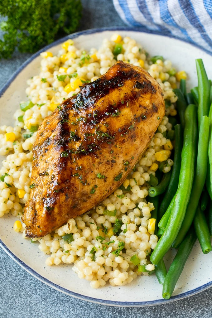 Chicken made with the best chicken marinade served over couscous with green beans.