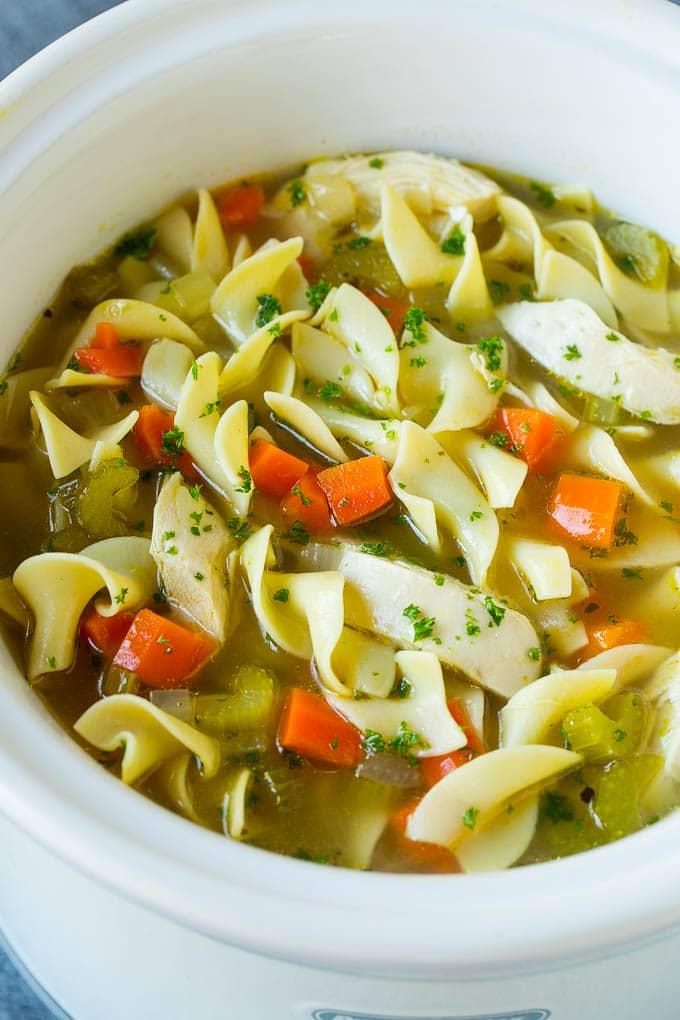 Crock pot chicken noodle soup with vegetables.