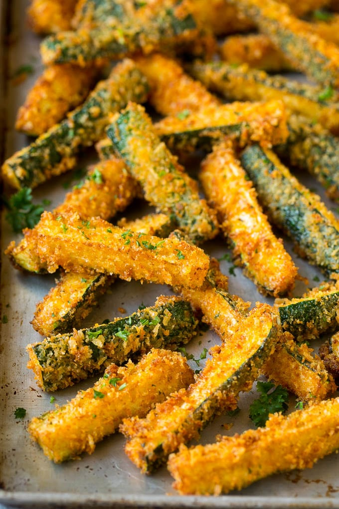 Fried zucchini sticks on a sheet pan.
