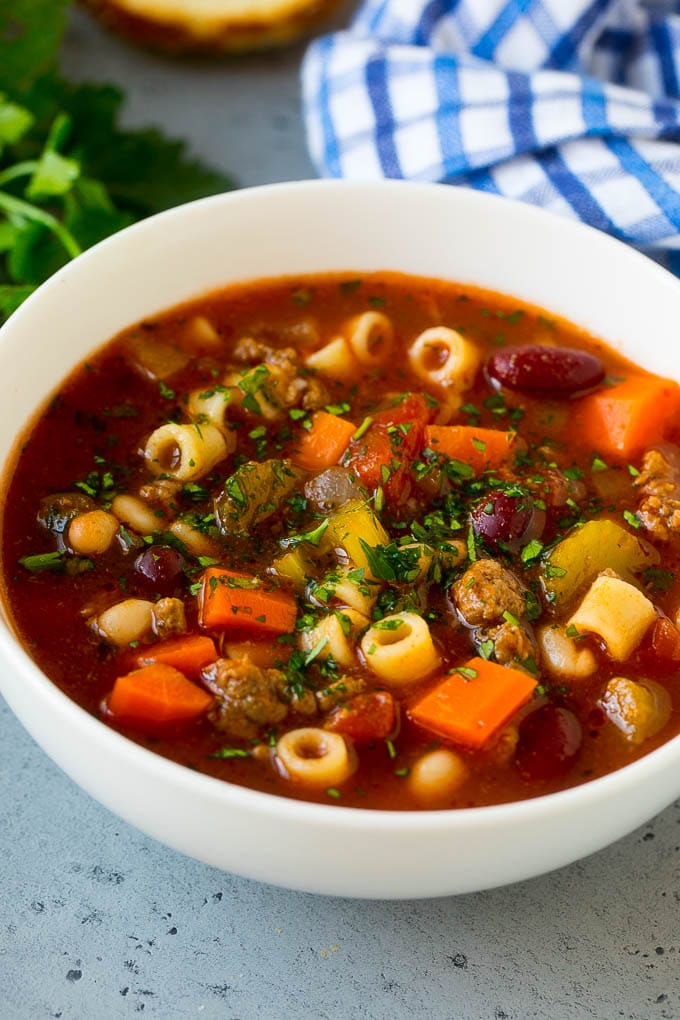 A bowl of pasta e fagioli soup with colorful veggies, ditalini pasta, two types of beans and ground beef.