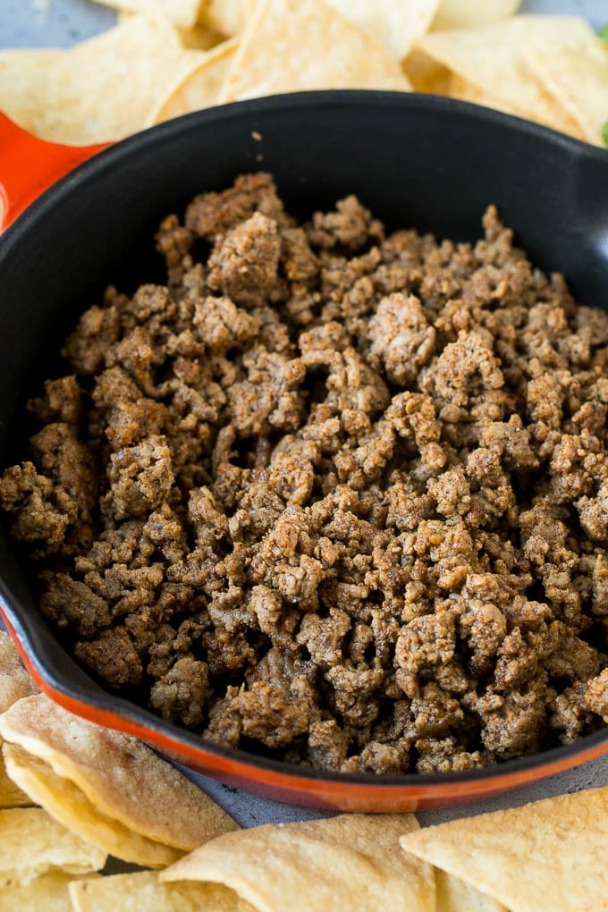 Cooked ground beef in a skillet.