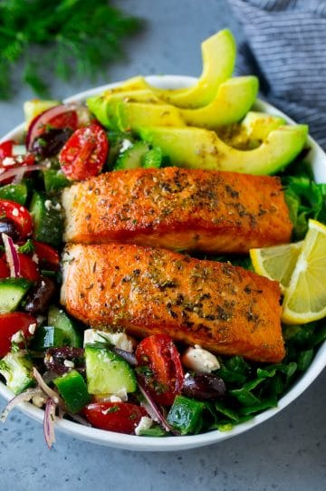 Salmon salad made with seared salmon fillets, vegetables, avocado olives and feta cheese.