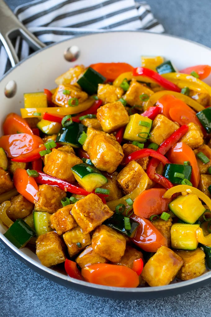 Tofu stir fry with peppers, carrots and zucchini in honey garlic sauce.