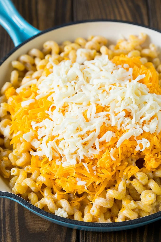 Noodles topped with two types of shredded cheese.