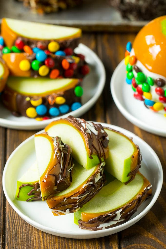 Sliced caramel apples on a plate.