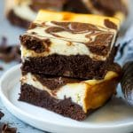 Cheesecake brownies with a rich brownie base and cream cheese topping.