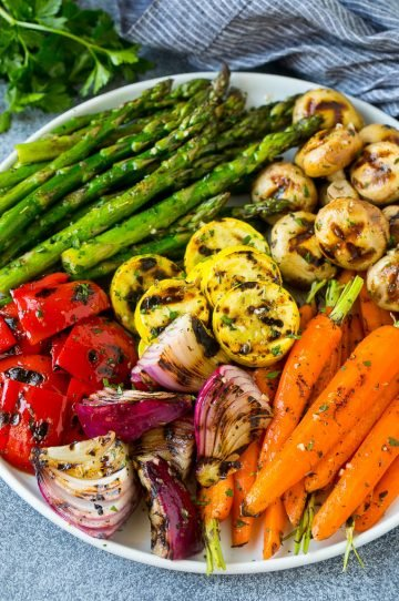A colorful platter of grilled vegetables flavored with garlic and herbs.