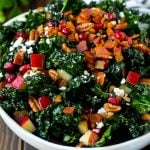 Apple kale salad topped with bacon and pecans.