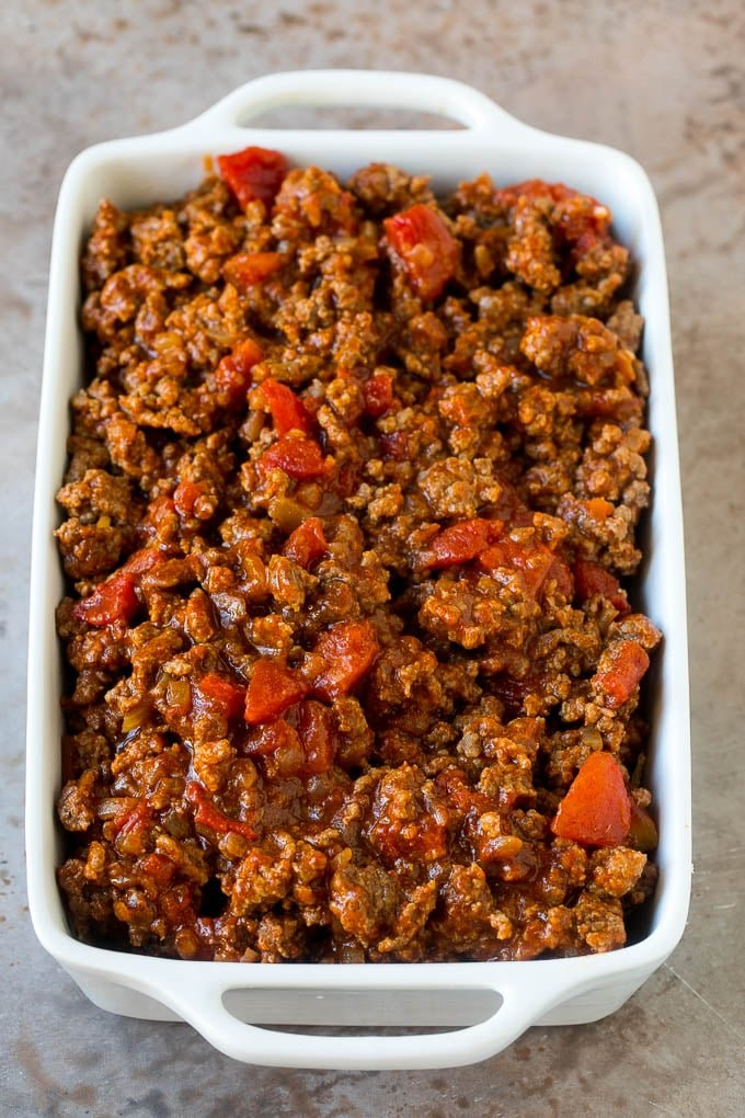 Cooked taco meat in a casserole dish.