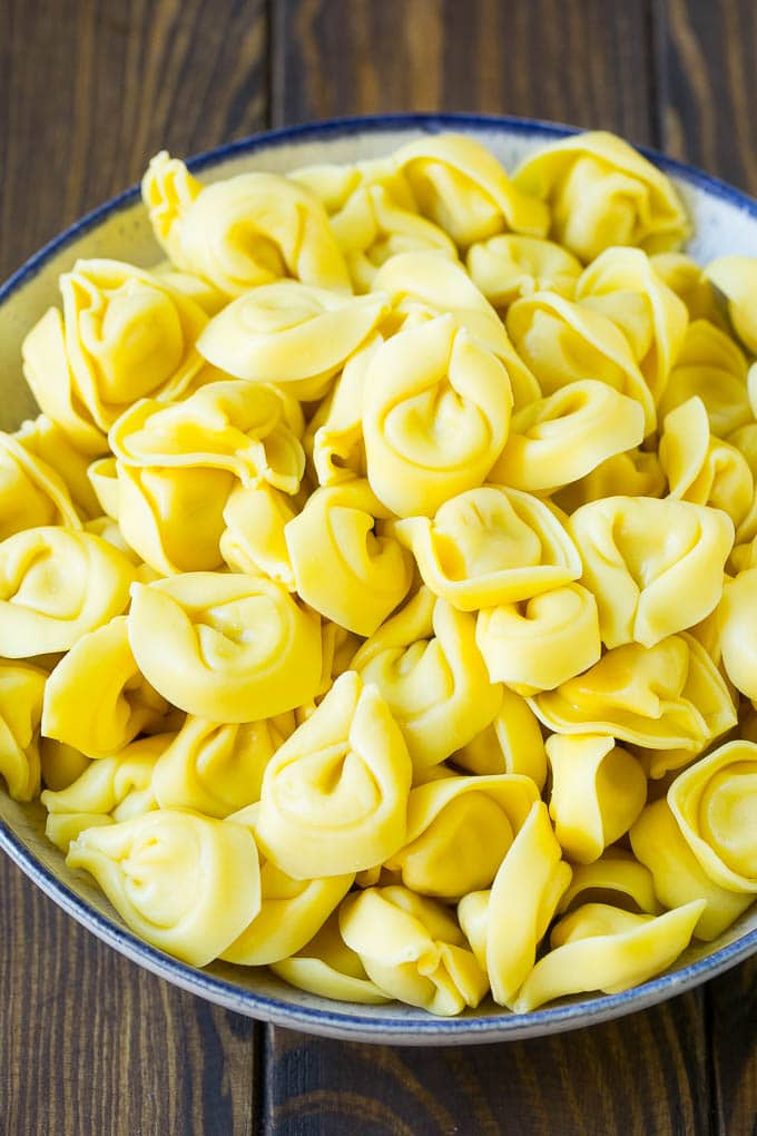 A bowl of cooked cheese tortellini.