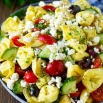 Tortellini salad with cucumber, tomato, olives and feta cheese.