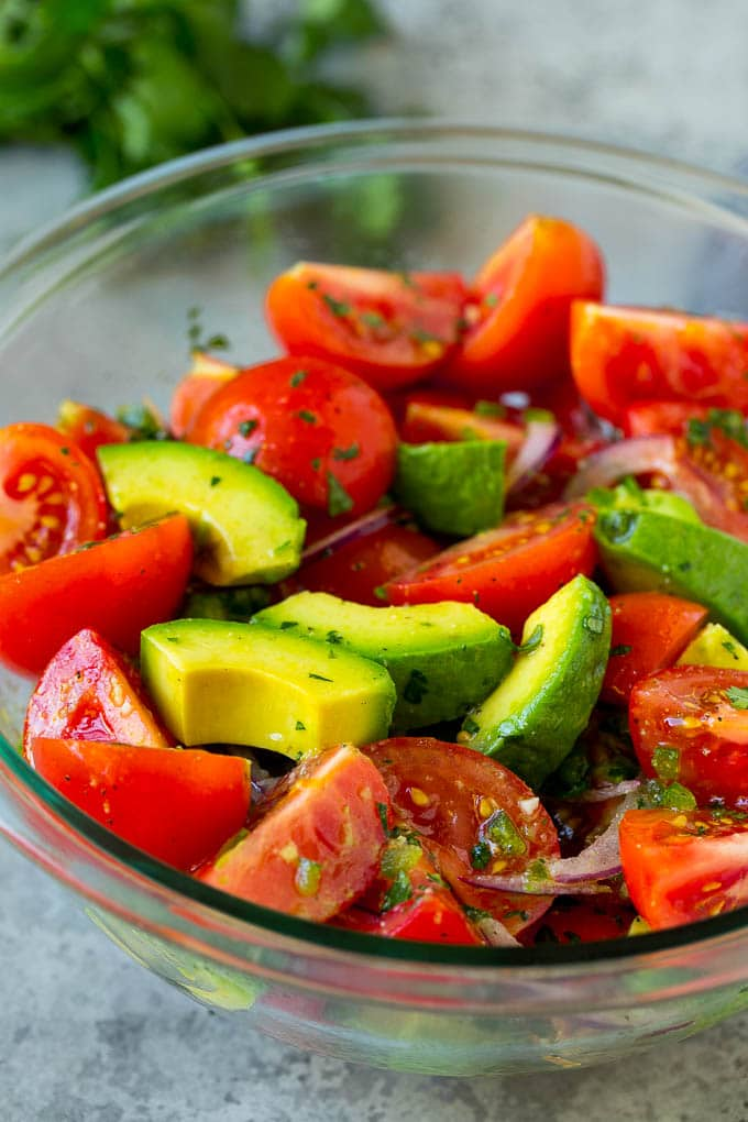 Avocado salad with tomatoes and red onion.