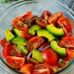 Tomato avocado salad with red onion and a cilantro lime dressing.