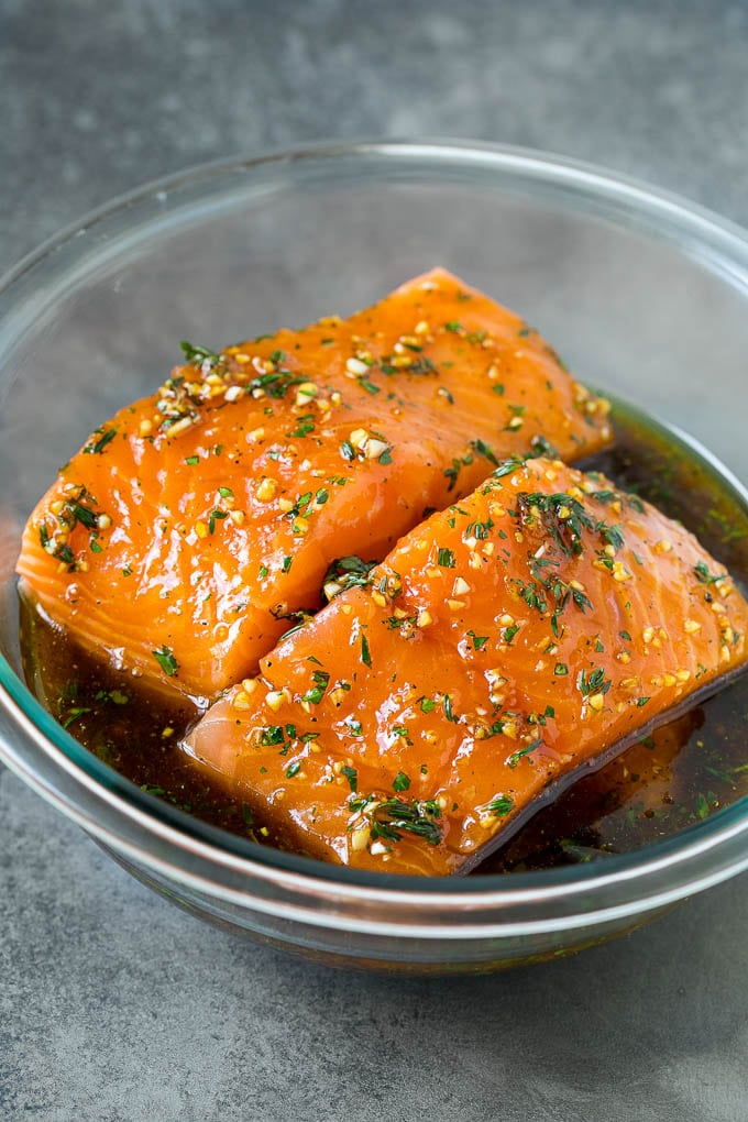 Salmon fillets in a garlic and herb marinade.